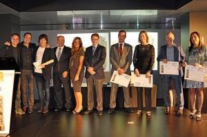 Jordi Cruz recogiendo el premio en la edición de 2014 de la mano de los hermanos Torres por el Abac Restaurant Hotel.